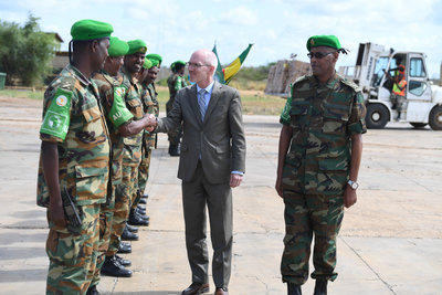 The UN Secretary-General's Special Representative for Somalia, James Swan receives a guard of honor by AMISOM troops at Baidoa Airport while during a visit to Baidoa, South West State, on 18 July 2019. UN Photo /Abdikarim Mohamed