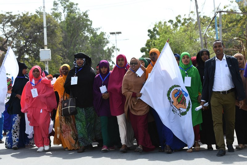 Youths march along Makka Al-Mukarama road during a peace walk to mark the International Youth Day held in Mogadishu on 12 August. Somali youth have become proactive in peace-building initiatives in various parts of the country.