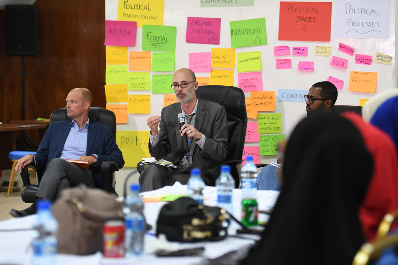 Goerge Conway (right), the Deputy UN Secretary-General's Special Representative for Somalia, and UN Resident and Humanitarian Coordinator, speaks during a dialogue organised by the world body for youth in Mogadishu, aimed to empower them to participate in