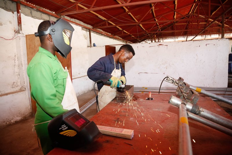 A trainee grinds metal during a vocational training in Kismaayo Technical Institute, Somalia. The trainee is one of the beneficiaries of the 'Dal Dhis' project, launched by UNIDO, which provides vocational training to youths in Kismaayo.