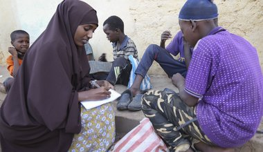 Jamila Haji Mohamed, Chair-lady of the Mis-Hurty Arlaathey organization, takes the contact information of children leaving on the streets of Baidoa, Somalia. Jamila has helped enroll street children in formal schools.