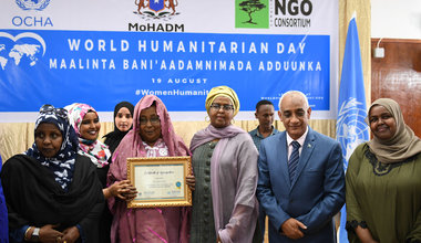 Asha Shaur Ugas holds a certificate awarded to her in recognition of her contribution to the promotion of humanitarian work. This was during an event to mark the World Humanitarian Day on 19 August 2019 in Mogadishu, Somalia. UN Photo / Omar Abdisalan