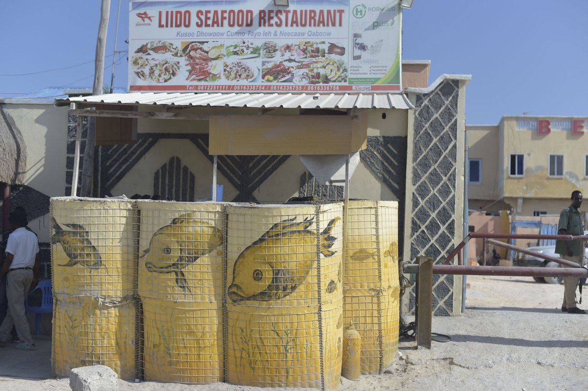 Decorated hescos, which serve as defense barriers for the Lido Seafood Restaurant, are some of those painted by members of Aqiila Art Group based in Mogadishu, Somalia.