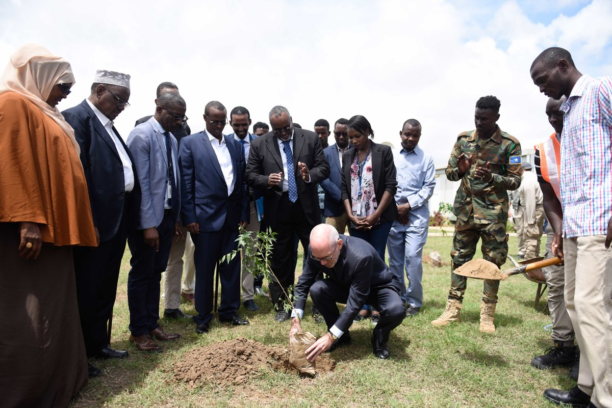 The UN envoy to Somalia, James Swan, plants a commemorative tree at the UN compound in Jowhar, HirShabelle State, Somalia, on 17 July 2019. UN Photo / Raymond Baguma
