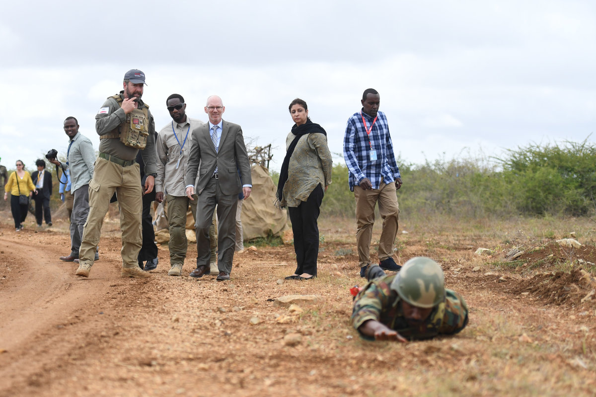 The UN Secretary-General's Special Representative for Somalia, James Swan, receives a brief on Improvised Explosive Device (IED) clearance demonstration during a visit to Baidoa, South West State, on 18 July 2019. UN Photo / Abdikarim Mohamed